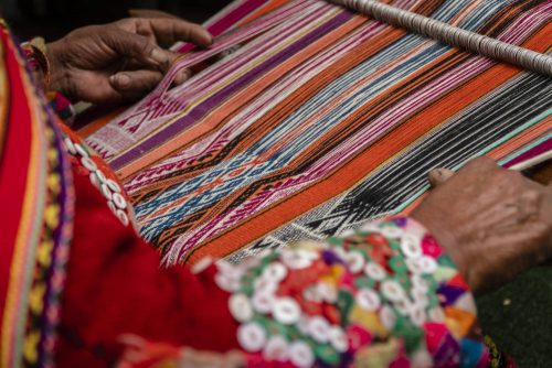 A demonstration of weaving with yarns that have been naturally dyed