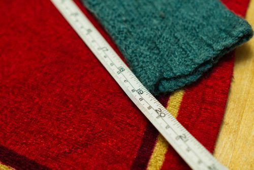 Using a tape measure helps you know when you've stretched your jumper back to its original size